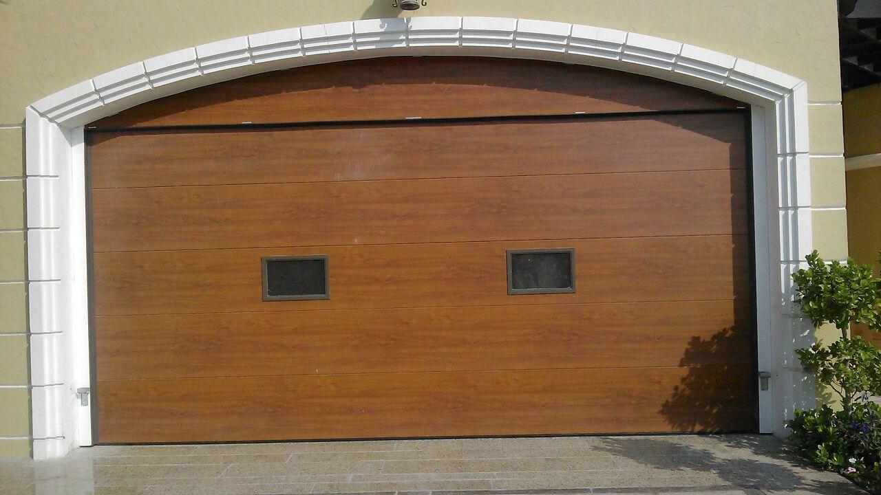 Browse through garage overhead sectional door spare parts new italpannelli residential garage overhead door golden oak panel rubansaba